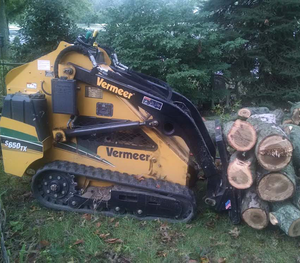 Picture of our machinery moving logs that were cut down for a customer in Joliet, IL